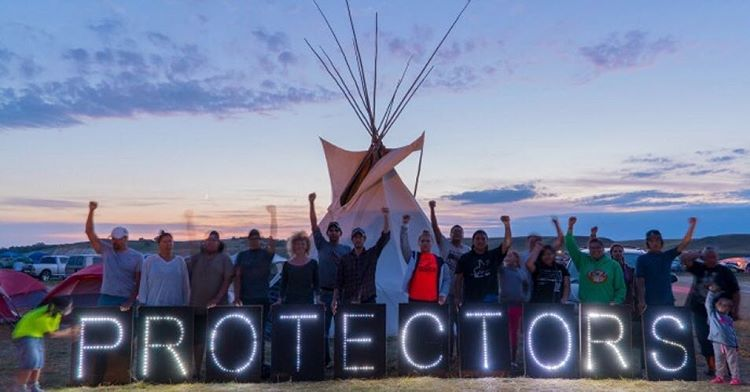 The whole world is watching Congratulations water protectors! Protestors celebratehellip